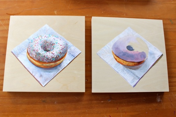A finished doughnut painting alongside one that's about a third finished.
