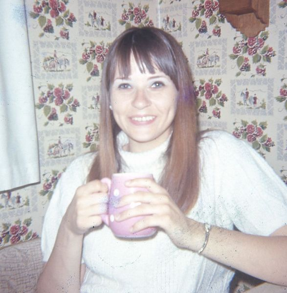 Mom, 1969, with her favorite coffee mug. (She's much younger that I am now)