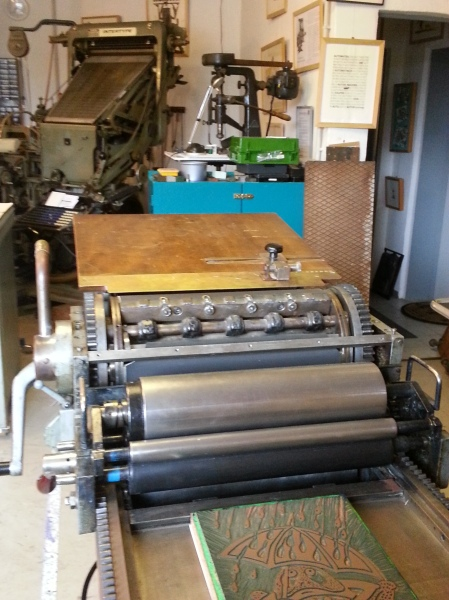 A modern press, the newest technology in the shop, sitting right next to some of the oldest technologies.