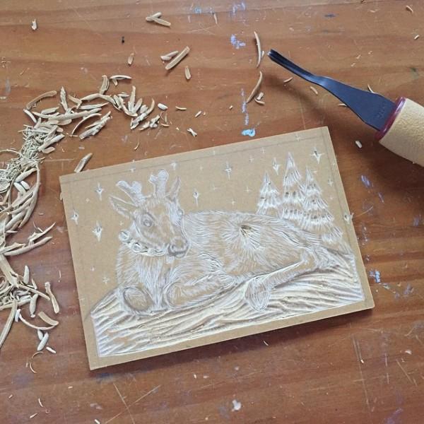 Carving the linoleum block.